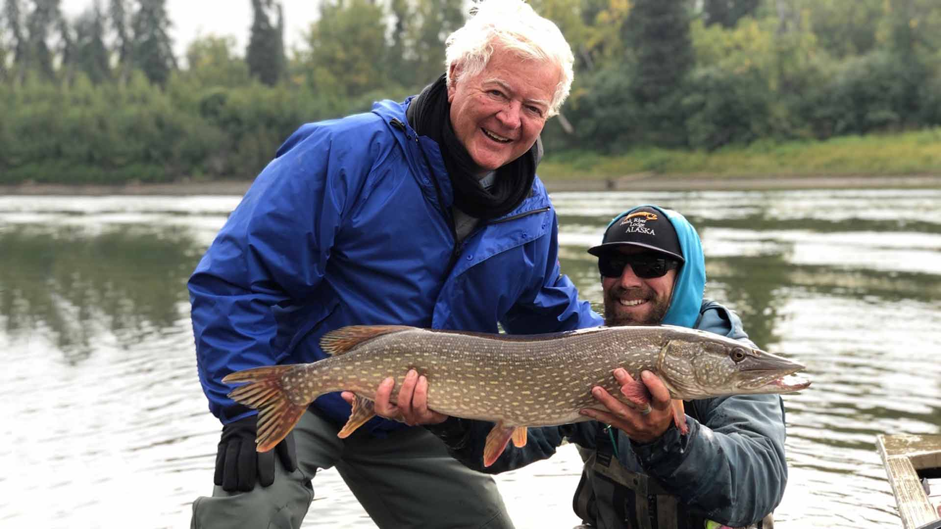 Guide holding up angler's northern pike